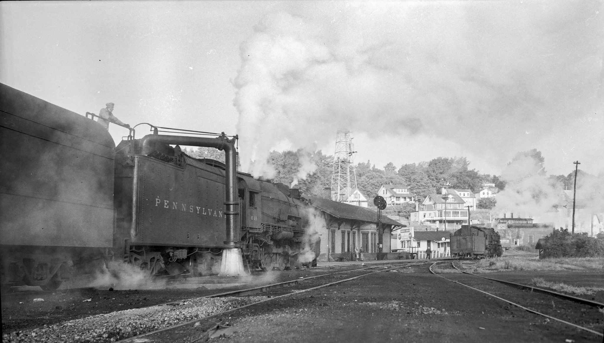 Pennsylvania Railroad 4 6 2 646 with a passenger train taking on water Watkins Glen NY in the 1940sjpg